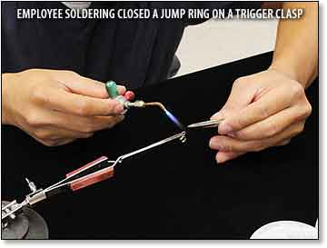 Employee Soldering Closed a Jump Ring on a Trigger Clasp